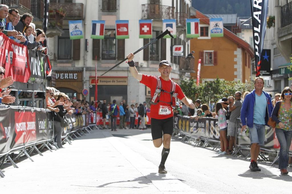 Martyn crosses the UTMB finish line in Chamonix