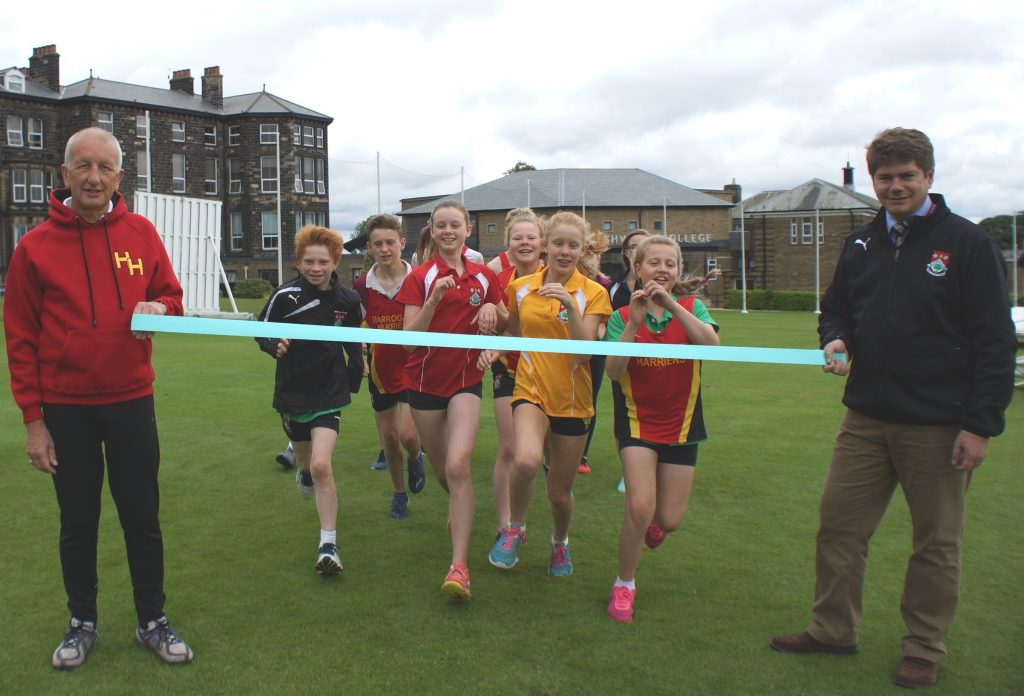 Club Chairman Tony Essex and Ashville College Headmaster Mark Lauder - and some very excited young runners!